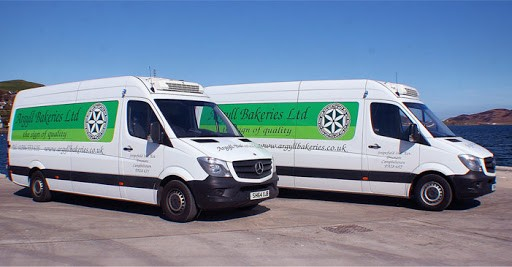 Image of two white vans with Argyll Bakeries livery